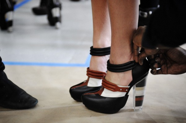 Tying shoe at Rodarte Backstage Fall-Winter 2012 03